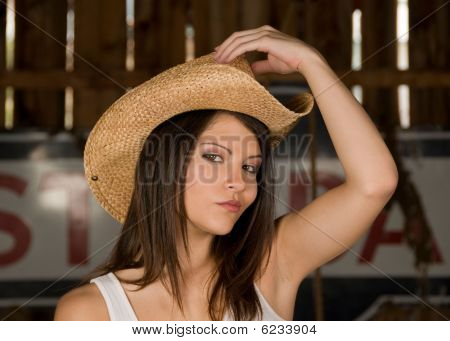 Beautiful young model in a cowboy hat