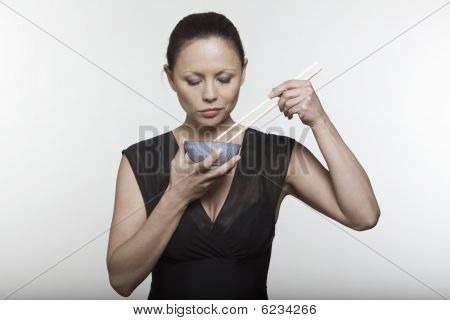 Woman Eating With Chopstick