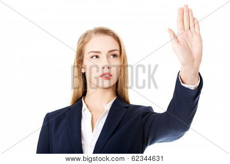 Beautiful business woman is having had up showing stop gesture. Isolated on white.