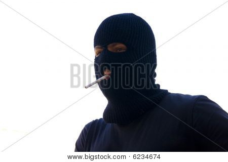 Young Man Wearing Black Ski Mask Holding A Cigarette Between His Lip