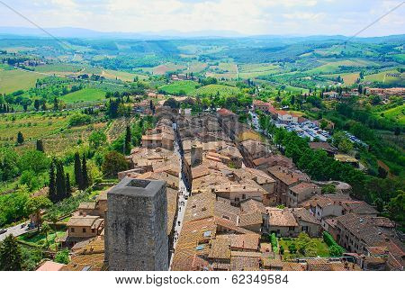 Unique View Of Medival Rooftops And Towers Of San Gimignano In Harmony With The Tuscany Countryside