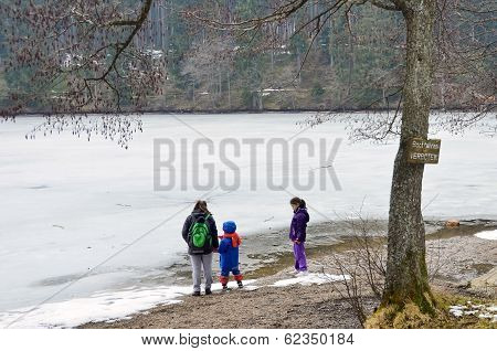 Kids Playing Near A Frozen Lake