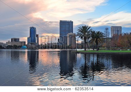 Orlando Lake Eola sunset with urban architecture skyline and colorful cloud