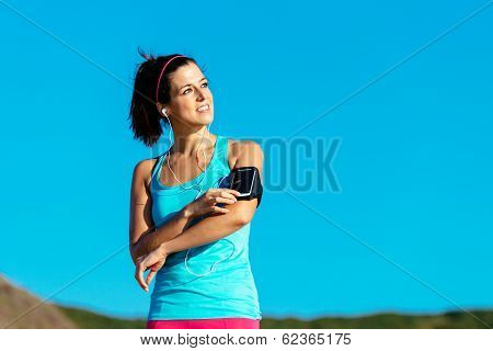 Woman With Smartphone Armband And Earphones