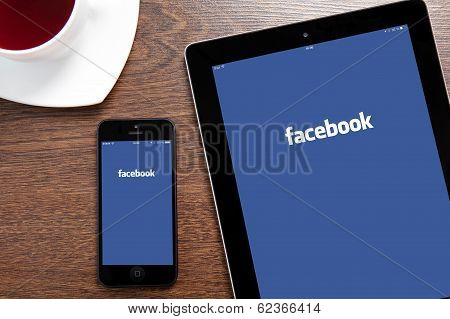 Ipad And Iphone With Facebook On A Screen