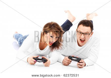 Young couple playing videogames on ground