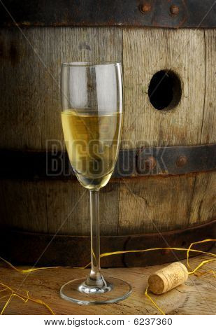 Glass of wine and barrel