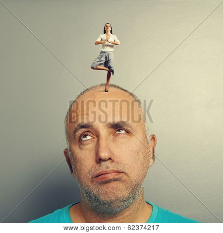 calm woman standing on the tired man over grey background