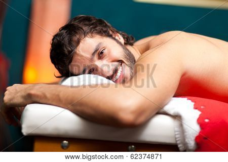 Man relaxing in a wellness center