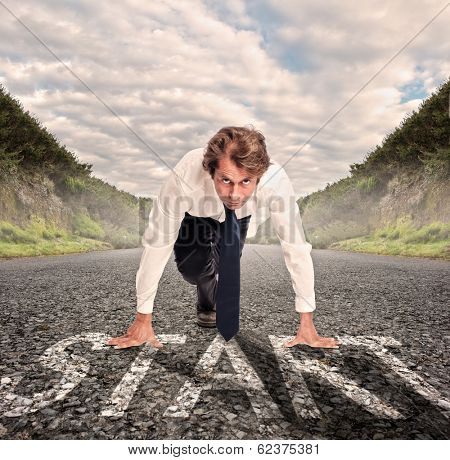 businessman on a road ready to run. Motivation concept