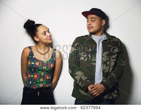 Young Couple Looking At Each Other With Attitude