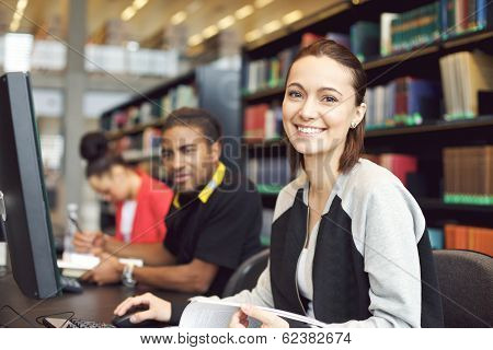 Beautiful Young Woman At Library Doing Online Research