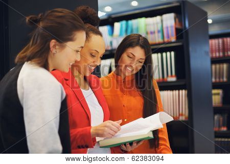 Three Young University Students Studying Together