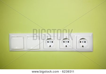Electrical Wall Outlet / On Green Background