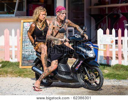 Guy And Girl On Motorbike