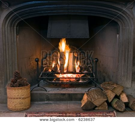 Stone Fireplace With A Lit Roaring Fire