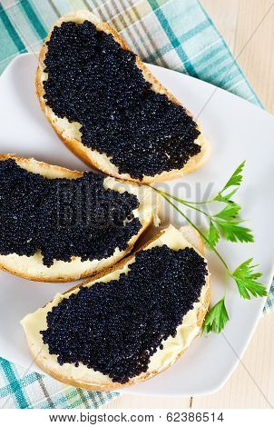 Black Caviar On A Slice Of Bread And Butter