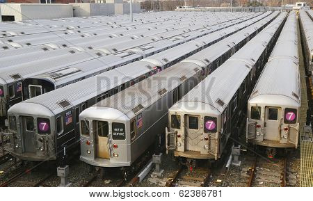 NYC subway cars in a depot