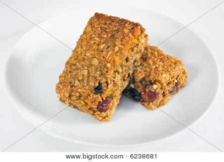 Two Flapjacks Stacked Together On A Plate