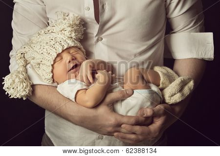 Newborn Baby Boy Smiling In Woolen Hat, Sleeping On Father Hand, Small Kid Happy Laughing
