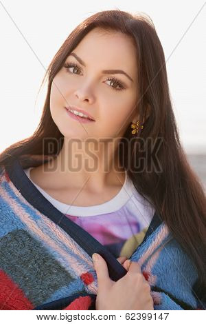 Brunette Woman Outdoors In Check Pattern Plaid