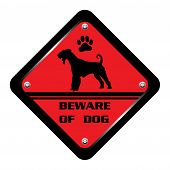 stock photo of dog footprint  - Red warning plate with dog silhouette and the text beware of dog written on the plate - JPG