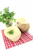 foto of rutabaga  - yellow Turnip with parsley and napkin on a bright background  - JPG
