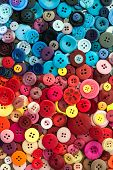 stock photo of sewing  - pile of assorted Colourful Sewing buttons background colours - JPG
