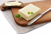 stock photo of margarine  - Slice of rye bread with butter - JPG