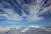 picture of aeroplane  - over the clouds out of an aeroplane window - JPG