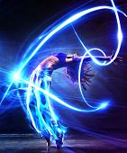 stock photo of dark side  - Young woman dancer - JPG