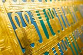 foto of hieroglyphs  - egypt hieroglyphs carved on a golden sargophagus