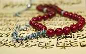 stock photo of prayer beads  - islamic rosary beads over quran writings paternoster - JPG