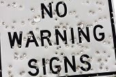 picture of clos  - Warning Sign with Bullet Hole clos up - JPG