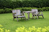 image of lawn chair  - Wooden chair in the garden with a lawn in the background - JPG