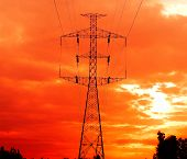 picture of electricity pylon  - Electricity pylons at sunset  cable line  construction - JPG
