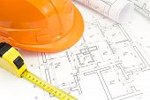 picture of workplace safety  - Engineer workplace with safety helmet blueprints and tape measure - JPG