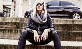 pic of stairway  - Fashionable blonde young woman in sunglasses sitting - JPG