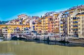 View Of Colorful Houses And Ponte Vecchio Bridge In Florence