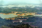 stock photo of medellin  - Beautiful lake at Guatape with a series of forested islands in it in Antioquia Colombia - JPG
