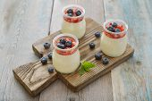 stock photo of panna  - Dessert panna cotta with fresh strawberry on wooden background - JPG
