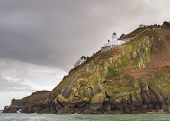 image of sark  - Coastal scene on Sark with a Lighthouse - JPG