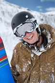 Smiling Snowboarder With Snowboard