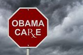 stock photo of mandates  - Stop ObamaCare Sign An American road stop sign with word ObamaCare with a stormy sky background - JPG