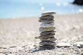 foto of fulcrum  - Pebbles in balancing on the sea coast - JPG