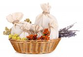 stock photo of sachets  - Textile sachet pouches with dried flowers - JPG