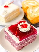 stock photo of cherry pie  - cake with mousse whipping cream and cherry on top - JPG