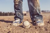 stock photo of infield  - baseball and sneakers in a baseball field - JPG