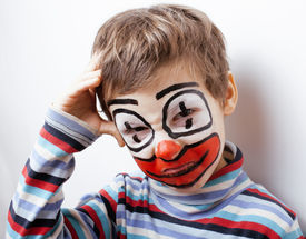 image of pantomime  - little cute boy with facepaint like clown - JPG