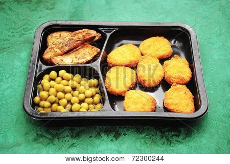 Chicken Nugget Tv Dinner Over A Green Background